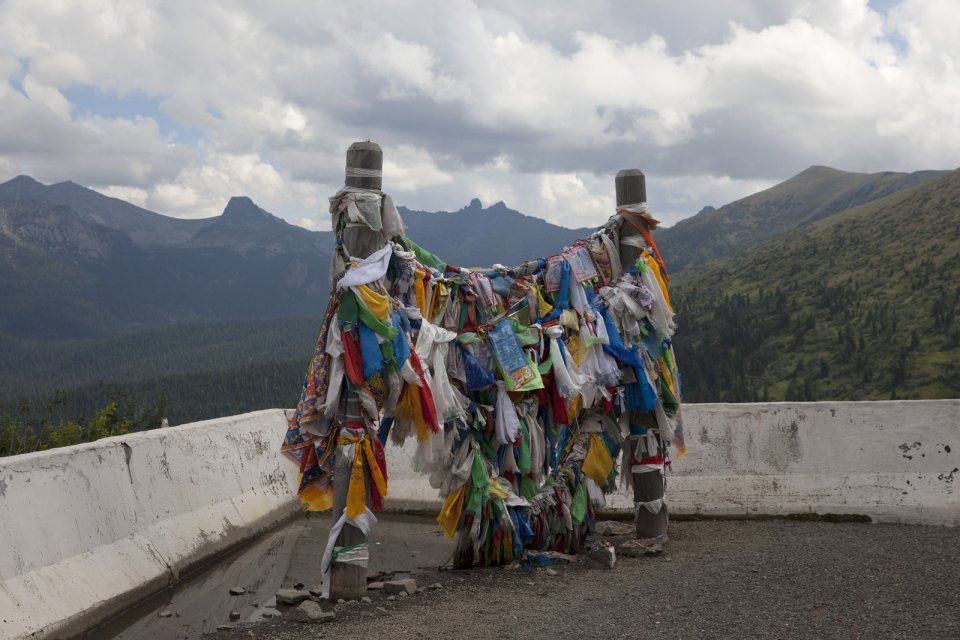 An ovaa - Buddhist prayer ribbons and blessing scarves tied to poles - at Buibinsky Pass on the M-54 - basically the only road that connects Tuva with the rest of Russia.
