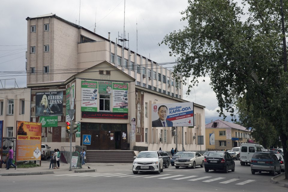 "A street scene in downtown Kyzyl, the capital of Tuva, with a campaign poster depicting the Tuvan governor Sholban Kara-Öol. Mr Kara-Öol, a trained political scientist, was first appointed governor of Tuva by president Putin in 2007. A snap gubernatorial ""election"" is slated for 18 September 2016 although there are few signs of any campaigning here as ""elections"" in Russia have become a hollow formality, with all major decisions taken through opaque inner workings of the ruling elite."