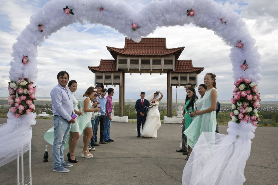 Choiganmaa, a journalist, and Shoraan Kuular, a stock farmer, celebrate their wedding with friends at a symbolic gateway to Tuva outside the capital Kyzyl where its future railway station is supposed to sit. Tuva was a vassal of the Chinese Qing Empire until 1912 and the Chinese influence, although largely forgotten, can still sometimes spring up in new monuments such as this one.