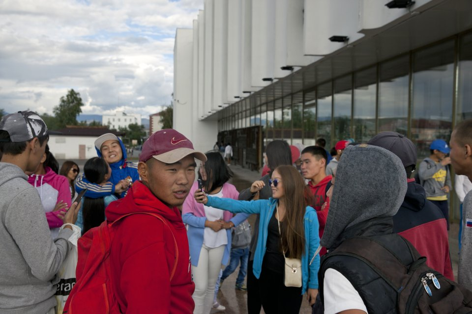 Young residents of Kyzyl hang out outside of the National Theater in the Tuvan capital Kyzyl. According to Kyzyl-based journalist and blogger Sayana Mongush, Tuvan youths who grew up in the capital speak mostly Russian because to speak Tuvan language is not considered socially prestigious anymore. To a Russophone, to be in Tuva creates a strange feeling of being abroad and at home at the same time: most Tuvans do however still speak Tuvan between themselves - it's the language you hear most often here. Anyone speaking Russian could be heard rather rarely but all signage in the region is in Russian.