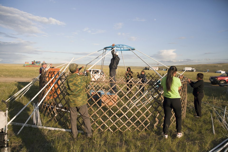 Building a yurt for the yearly stock farmers' festival Naadym (pronounced 'Nah-Dim) which includes various competitions such as the Best Yurt, horse racing, arching, wrestling and cooking contests. Tos-Bulak, Tuva, Russia.