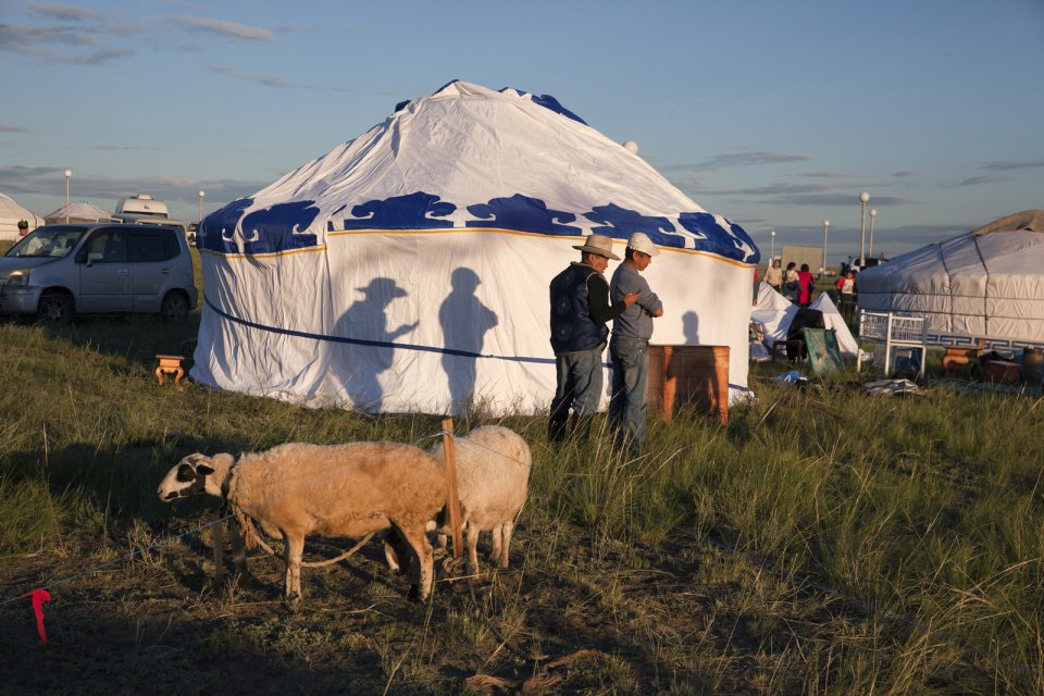 Farmers prepare for the yearly Naadym festival (pronounced 'Nah-Dim), an important element of today's Tuvan identity which includes various competitions such as Best Yurt, horse racing, arching, wrestling and cooking contests. During Soviet era, Naadym as well as other Tuvan folk activities were banned to help merge them into a single Soviet identity. Tos-Bulak, Tuva, Russia.