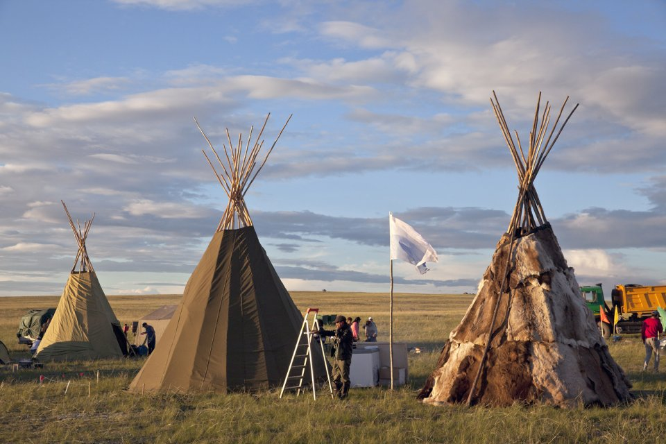 Deer farmers from the Todzha area (northeastern Tuva) known for its deep forests built these traditional tents for the yearly Naadym farmers' festival. Once nomadic deer farmers, Todzha Tuvans no longer live in this kind of tents, preferring village homes, but some of them still know how to build a tent for special occasions such as this Naadym fest. Deer were not brought over for they pasture deep in the forest during this time of year and their respiratory systems are not used to dusty steppes. Tos-Bulak, Tuva, Russia.