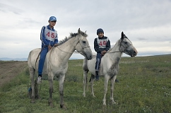 "Brothers Salgyn, 14, and Kheimer, 13, Dongak prepare for the annual 15-km horse race as part of Naadym farmers' festival. Both Salgyn and Kheimer have been jockeys since the age of 8. Race rules allow neither saddles nor helmets. ""If we wore them, we would be laughed at"", the brothers said."