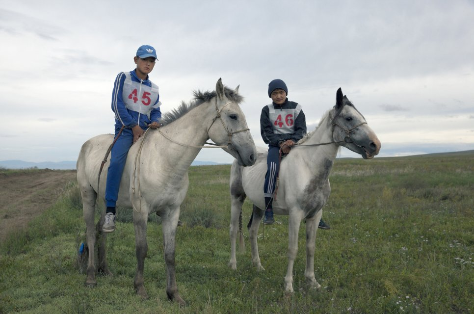 "Brothers Salgyn, 14, and Kheimer, 13, Dongak prepare for the yearly 15-km horse race as part of Naadym farmers' fest. Both Salgyn and Kheimer have been jockeys since the age of 8. Tuvan race rules allow neither saddles nor helmets. ""If we wore them, we would be laughed at"", the brothers said. Tos-Bulak, Tuva, Russia."
