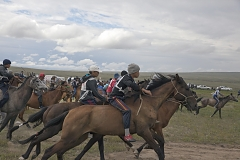 Start of the 15-km horse race as part of the annual farmers' festival Naadym. Rules allow neither saddles nor helmets. Boys can become jockeys since the age of 6.