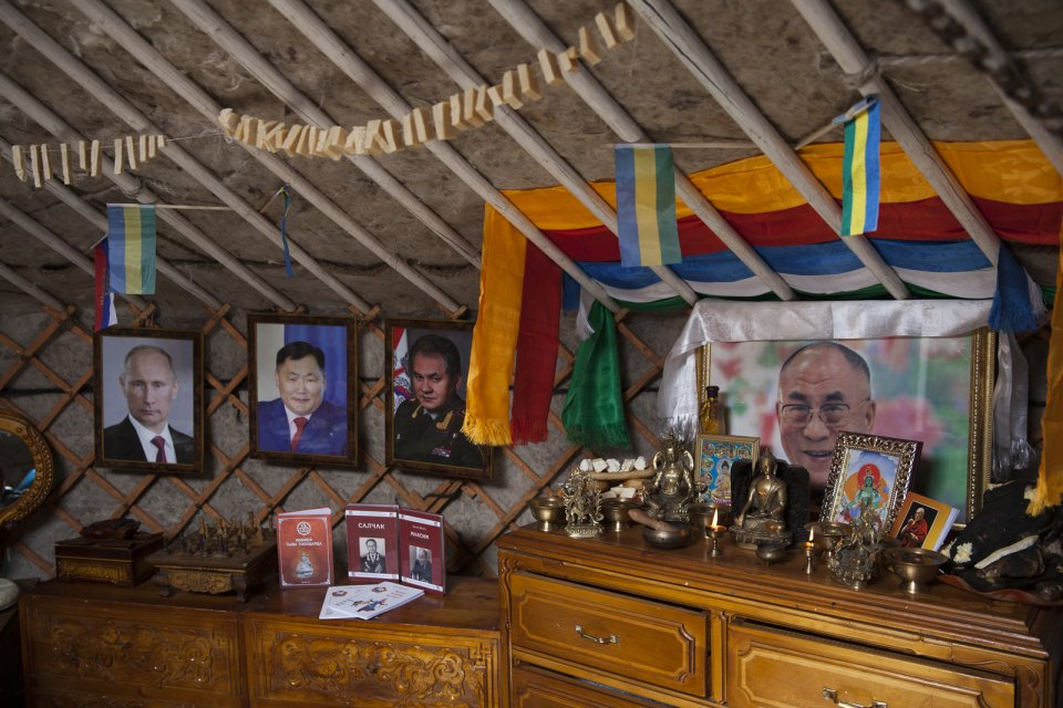 Inside a yurt participating in the Best Yurt contest as part of the yearly Naadym farmers' festival; portraits are those of Russian president Vladimir Putin, Tuvan governor Sholban Kara-Öol, Russian defense minister and a native of Tuva Sergei Shoigu, and Dalai-Lama. This yurt eventually won the contest. Tos-Bulak, Tuva, Russia.