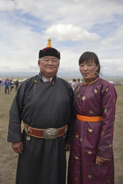 Oleg Khertek, head of Tuva's Erzin district bordering Mongolia, with his deputy Bayirma Izhigin attending the yearly Naadym farmers' festival in folk costumes. These were banned during the Soviet era but are now worn only on special occasions such as the Naadym fest. Tos-Bulak, Tuva, Russia.