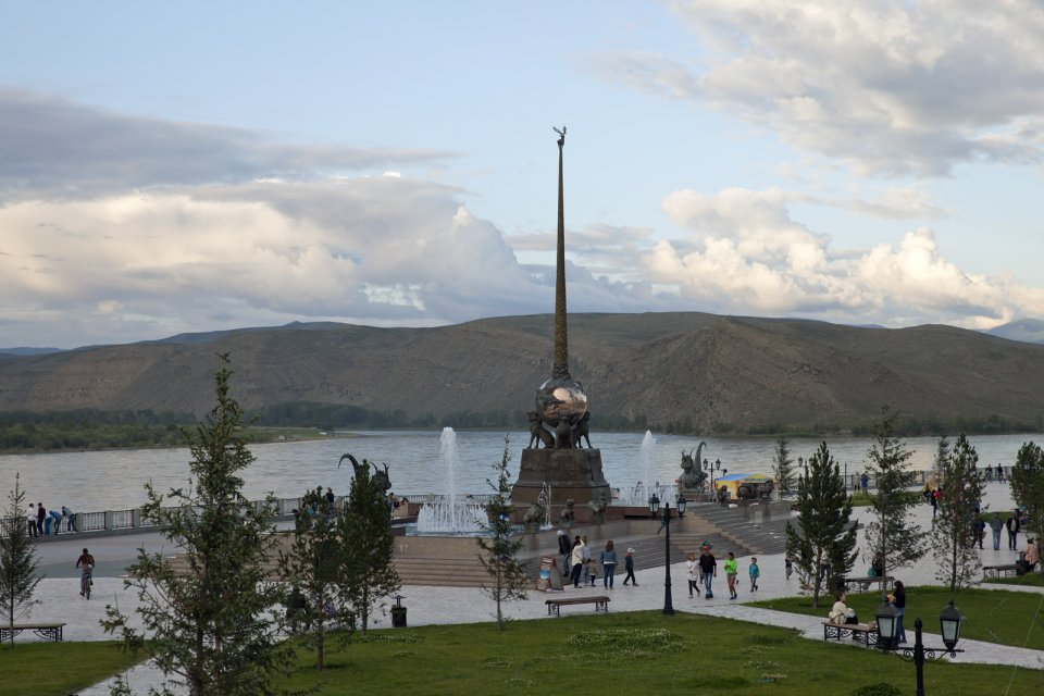 "An obelisk by Russian artist of Buryat origin Dashi Namdakov marking what is believed here to be the geographical center of the Asian continent. Why exactly was this place chosen as such is unknown but a Russian engineer who authored a 1910 book about what would later become Tuva mentioned an English traveler who had come to the area willing to see the ""center of Asia"". The confluence of Kaa-Khem and Piy-Khem rivers forming Yenissei - Russia's longest river - is visible in the background."