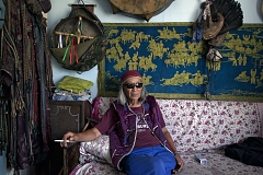 "Nikolay Öorzhak, a shaman, in his Kyzyl office. Trained as a stage designer in Moscow, he later served as art director of the Tuvan National Theater in Kyzyl. In 1990, he founded Tuva's first community of shamans. ""You can understand shamanism only if you become a shaman yourself. Shamanism is not a religion"", he says, ""it is a foundation of all religions. God is the energy of the universe, all else - Buddha, Christ - are just images"". Mr Öorzhak says he receives many Western visitors, mostly psychologists, and has traveled extensively around the world."