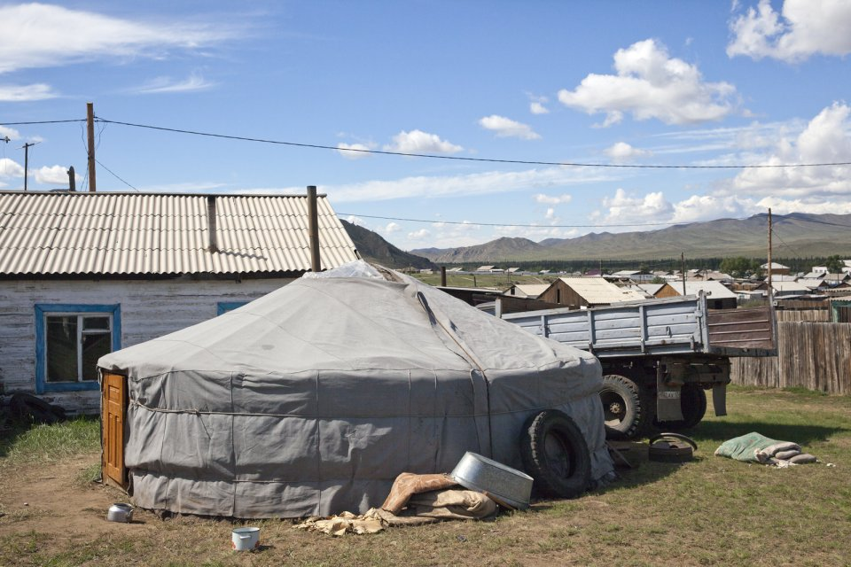 Bandan family home and a yurt in Naryn, southeastern Tuva. In summer, two generations of the Bandan family live in two yurts in the Kachyk river valley, some 100 km east of Naryn, from fall to spring the younger part returns to Naryn in order for the kids to attend school.