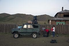 Ertine Bandan (on the roof of the vehicle) unloads the luggage near the home of Bayir-Kys Banchyk - director of the village hall (in red sleeveless jacket) whom he gave a ride - in front of her home in Kachyk, a remote and hard-to-get village near the Mongolian border. The isolated Kachyk community has about 300 residents, partly living in the village itself, partly - at nomadic stations in the surrounding valleys. According to Moscow-based sociologist Artemiy Pozanenko who has been studying spacially isolated communities in the post-Soviet world, they tend to be more cohesive and self-sustainable because in part of unlimited access to natural resources around them and absence of regulatory authorities.