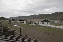 Kachyk, a remote and hard-to-get village near the Mongolian border. The building with the antenna on the right is the village's elementary school. The isolated Kachyk community has about 300 residents, partly living in the village itself, partly - at nomadic stations in the surrounding valleys. There's no police, no doctors, no shops in the village. Electricity is produced by a portable generator and is only available when it's dark. According to Moscow-based sociologist Artemiy Pozanenko who has been studying spacially isolated communities in the post-Soviet world, they tend to be more cohesive and self-sustainable because in part of unlimited access to natural resources around them and absence of regulatory authorities. A school is the only institution in these communities thanks to which they continue to exist. In late 1960s, all residents of Kachyk have been airlifted by the Soviet authorities of Tuva to the nearest bigger village Naryn, about 100 km away, because of poor acess but after the breakup of the Soviet Union many of them returned to their ancestral homes.