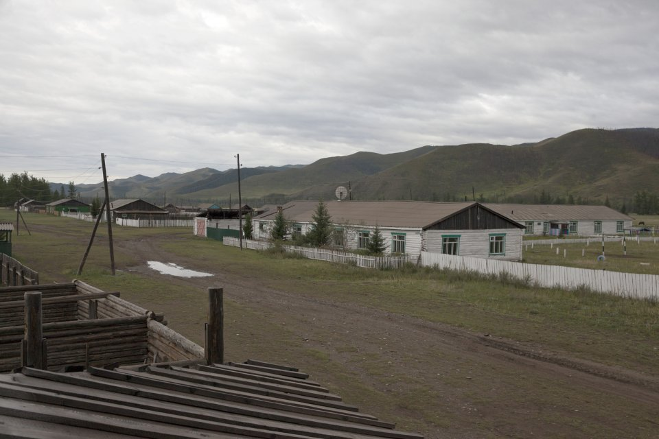 Kachyk, a remote and hard-to-get village near the Mongolian border. The building with the antenna on the right is the village's elementary school. The isolated Kachyk sumon (community) has about 300 residents, partly living in the village itself, partly - at nomadic stations in the surrounding valleys. There's no police, no doctors, no shops in the village. Electricity is produced by a portable generator and is only available when it's dark. According to Moscow-based sociologist Artemiy Pozanenko who has been studying spacially isolated communities in the post-Soviet world, they tend to be more cohesive and self-sustainable because in part of unlimited access to natural resources around them and absence of regulatory authorities. A school is the only institution in these communities thanks to which they continue to exist. In late 1960s, all residents of Kachyk have been airlifted by the Soviet authorities of Tuva to the nearest bigger village Naryn, about 100 km away, because of poor acess but after the breakup of the Soviet Union many of them returned to their ancestral homes.