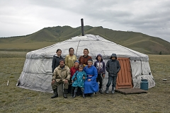 Shimitsi Khumbun, 79 (center, in red, with granddaughter Sanchira on her knees) was born and has been living in the Kachyk river valley for her entire life, she has 16 children (of which two live next to her to help her and are present in the picture - Robert to her left and Maya to her right), about 90 grandchildren and 19 great grandchildren. Standing from left to right Mrs Khumbun's grandchildren Angarmaa, Buyana, Gazhidmaa, Sanchay, and Nachyn.