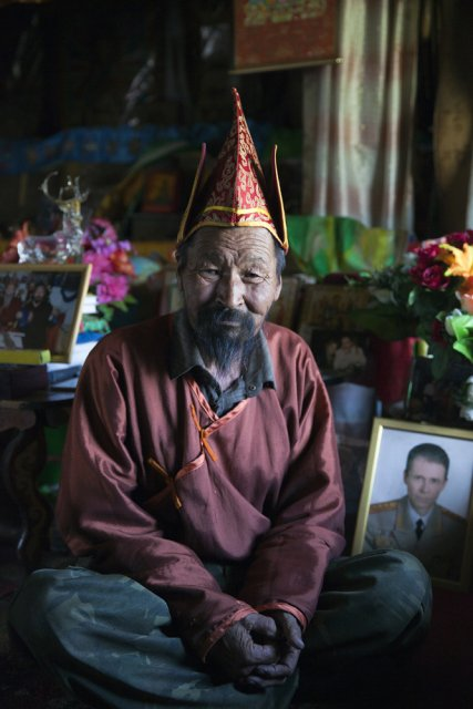 Boris Sodunam or simply Sodunam-Bashki (Sodunam the Teacher), 70, founded the first official Buddhist community in Tuva when open religious practices were allowed in 1990. He then became a hermit and has been living in seclusion for the last 20 years in this remote Sutluk river valley - his homeland in southeastern Tuva. Over this period, he has built a small monastery which consists of a temple, a house and a small hostel for disciples and visitors whom he receives in considerable numbers, including high-ranking Russian officials, such as a police general whose portrait he is posing for picture with.