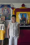 Chechekmaa Ishina, 53, poses for picture in front of an altar in the house in Chadan she has built on her own savings for her teacher - Tibetan monk Shivalkha Rinpoche. Reverend Rinpoche has lived in Tuva for 7 years and has become very popular among Tuvan Buddhists until he was deported at the order of the Federal Security Service in 2015.
