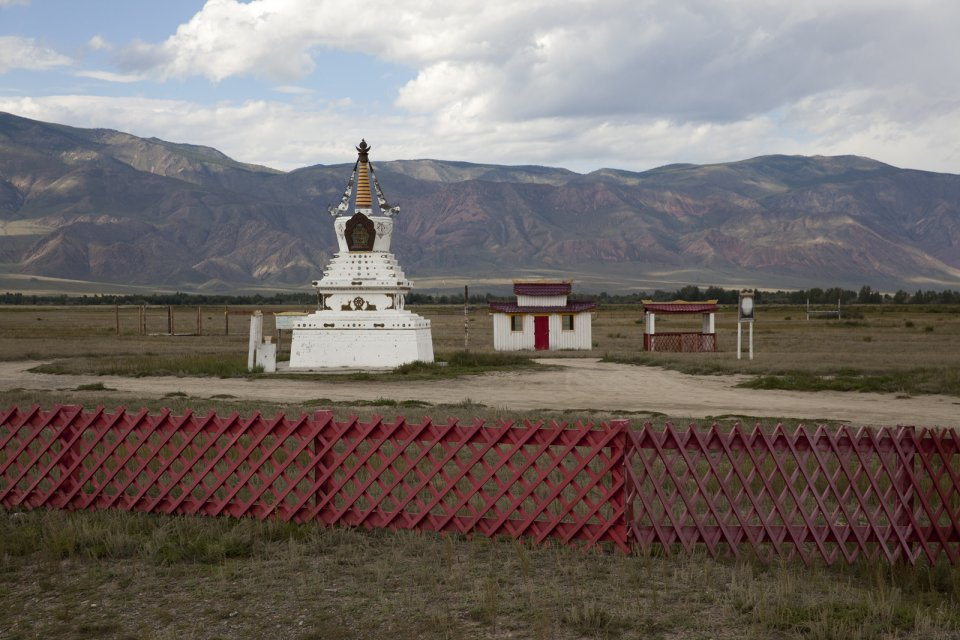 Buddhist sanctuary Dupten Sheduplin near Sug-Aksi in western Tuva, with Alash Plateau visible in the background. After Tuva has formally joined the Soviet Union in 1944, all monks were prosecuted and temples completely destroyed to help Communist ideology take hold instead. After the breakup of the Soviet Union, Buddhism has seen a controversial revival in Tuva, although it's the religion's power consolidating potential rather than its true meaning that's being prioritized by the authorities all over Russia irrespective of whether it's Christianity, Islam or Buddhism.