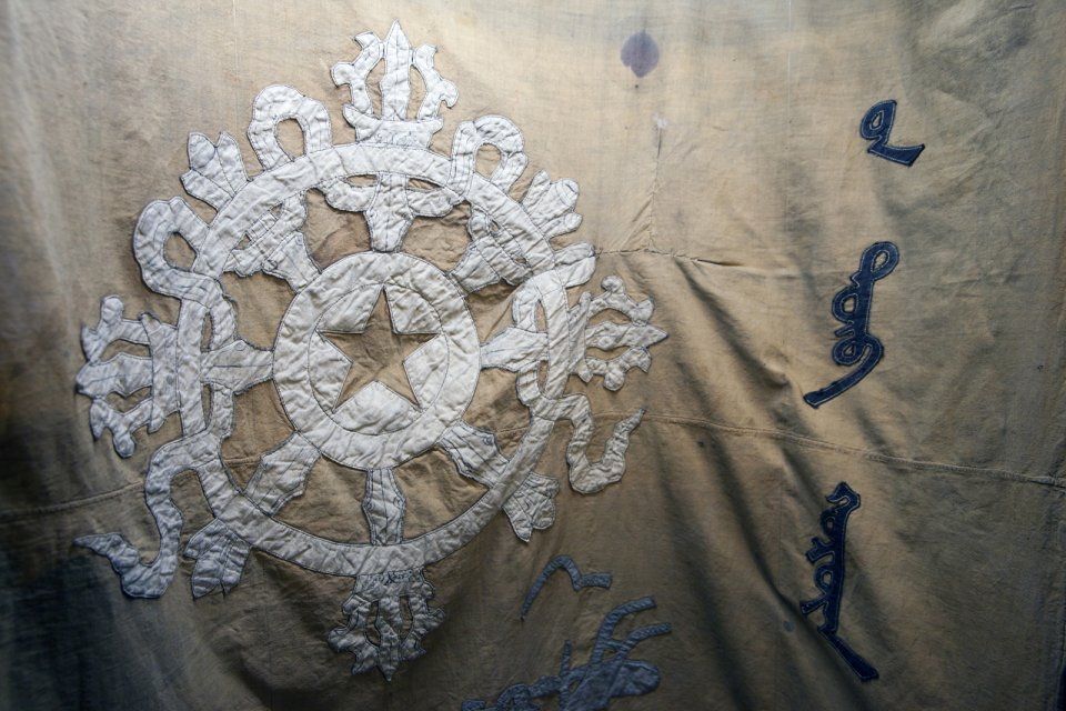 Detail of the first Tuvan flag dating back to 1921 preserved at the National Museum in the capital Kyzyl. Once part of a vast medieval Turkic Khaganate, the territory of the present-day Tuva changed hands many times. From mid-18 century and up until 1912 it was a province of the Chinese Qing Empire. China did not rule Tuvans directly though, outsourcing it to the Mongols, themselves part of the Qing Empire until 1911. When the latter fell apart, the Tuvan tribal leaders appealed to the Russian tsar Nicholas II for protection, and in 1914 a Russian protectorate known as Uriankhai Territory (a Mongol term for Tuvans) was established and its capital Belotsarsk (City of the White Tsar) founded. When the Russian Empire collapsed in turn just 3 years later, Tuva was left on its own until 1921 when it declared independence but delegated foreign policy to the new Soviet Russian government. It was only recognized by neighboring Russia and Mongolia though. Other countries continued to consider it a Chinese territory. Up until 1944 when the People's Republic of Tuva has formally joined the Soviet Union, it was de facto a Soviet protectorate as well, a sort of the Soviet Puerto Rico. Interestingly, the government of the Republic of China (Taiwan) continues to formally consider Tuva part of Greater China. Unusually for an overcentralized Russia, Tuva celebrates its main holiday coinciding with the day of independence (15 August) not the day when it was incorporated into the Soviet Union (11 October).