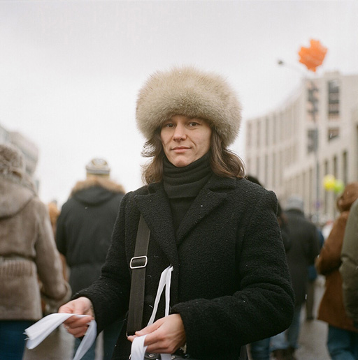 Anya, an activist with the NGO Citizen Observer, handing out white ribbons - the symbol of current protests, to which prime minister Putin infamously referred to as 'condoms'