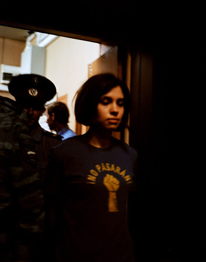 Member of Pussy Riot Nadezhda Tolokonnikova being escorted by police from the court on July 4, 2012