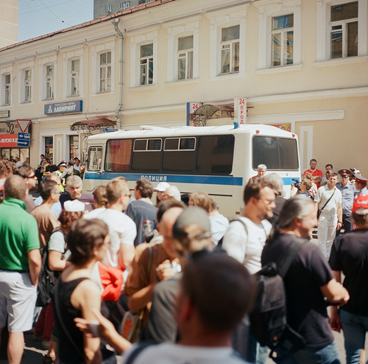 A crowd of supporters and opponents of Pussy Riot as well as media and a police bus near Tagansky Disctrict court in Moscow on July 4, 2012