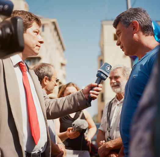 Opposition politician Boris Nemtsov being interviewed by WDR near the court where the Pussy Riot case is being heard, July 30, 2012